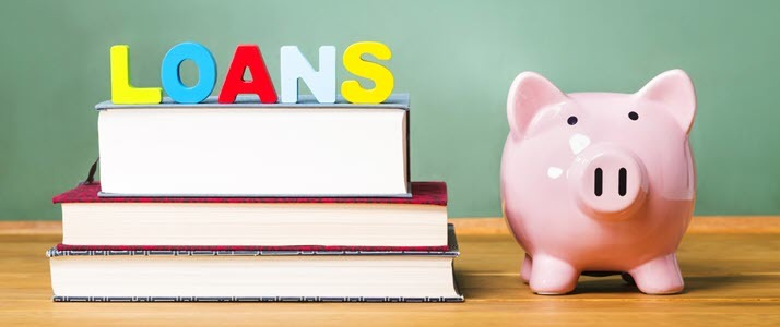 Student loan over textbooks with piggy bank