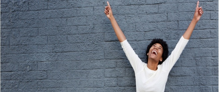 A happy employee is excited about accomplishing a goal.