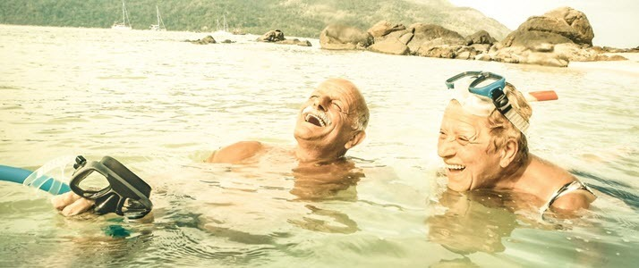 Senior couple having fun snorkeling