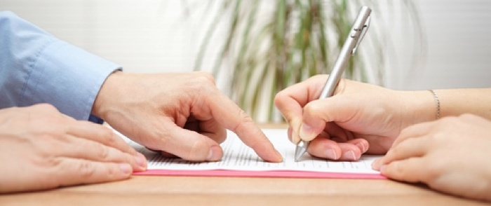 An employee signs a separation agreement.