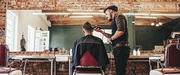 A barber giving a man a haircut