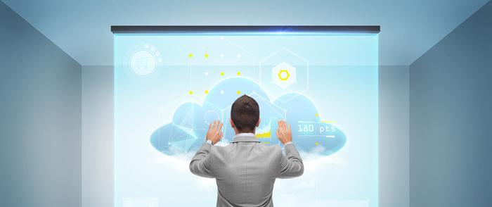 A businessman works with a cloud on a virtual screen.