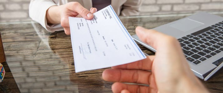 A check is handed to an employee