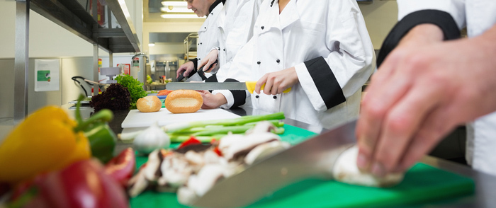 A line of cooks preparing food