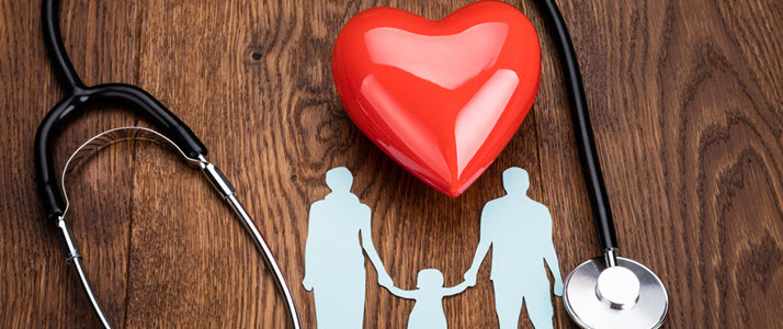 A photo illustration shows a cutout of a family near a heart and stethoscope