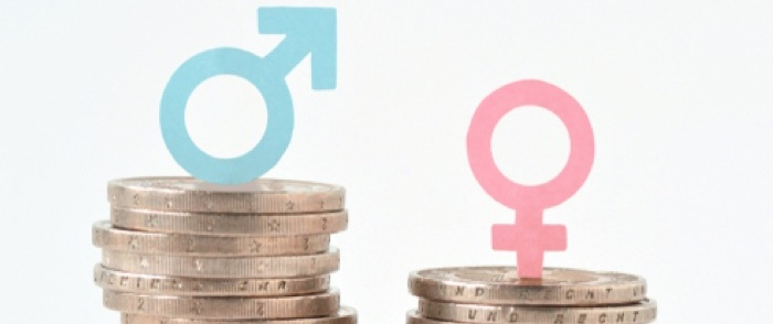 Unequal stacks of money illustrate the wage gap between men and women.