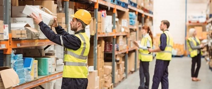 Seasonal employees work in a distribution warehouse.