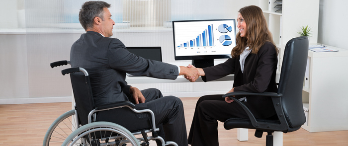 An employee in a wheelchair arrives for a job interview.