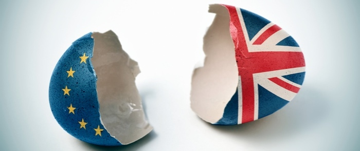 An egg shell is split into two halves which are painted to represent the EU and Britain