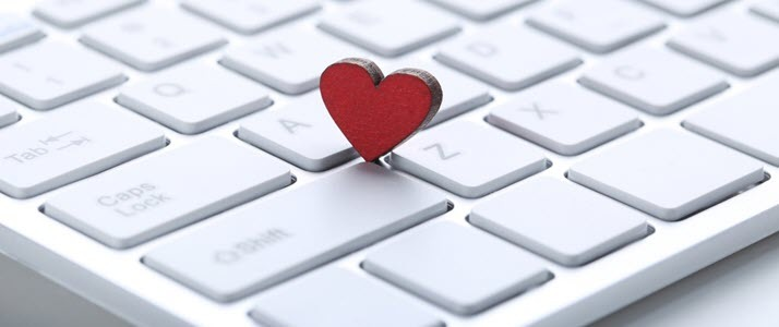 Red heart on computer keyboard